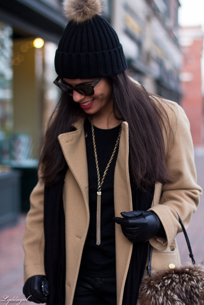 black jeans, black sweater, camel coat, fur pom hat-4.jpg