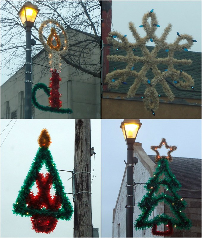 colorful tinsel - candle, white snowflake with blue lights, a triangle-shaped tree, and a three-tiered tree
