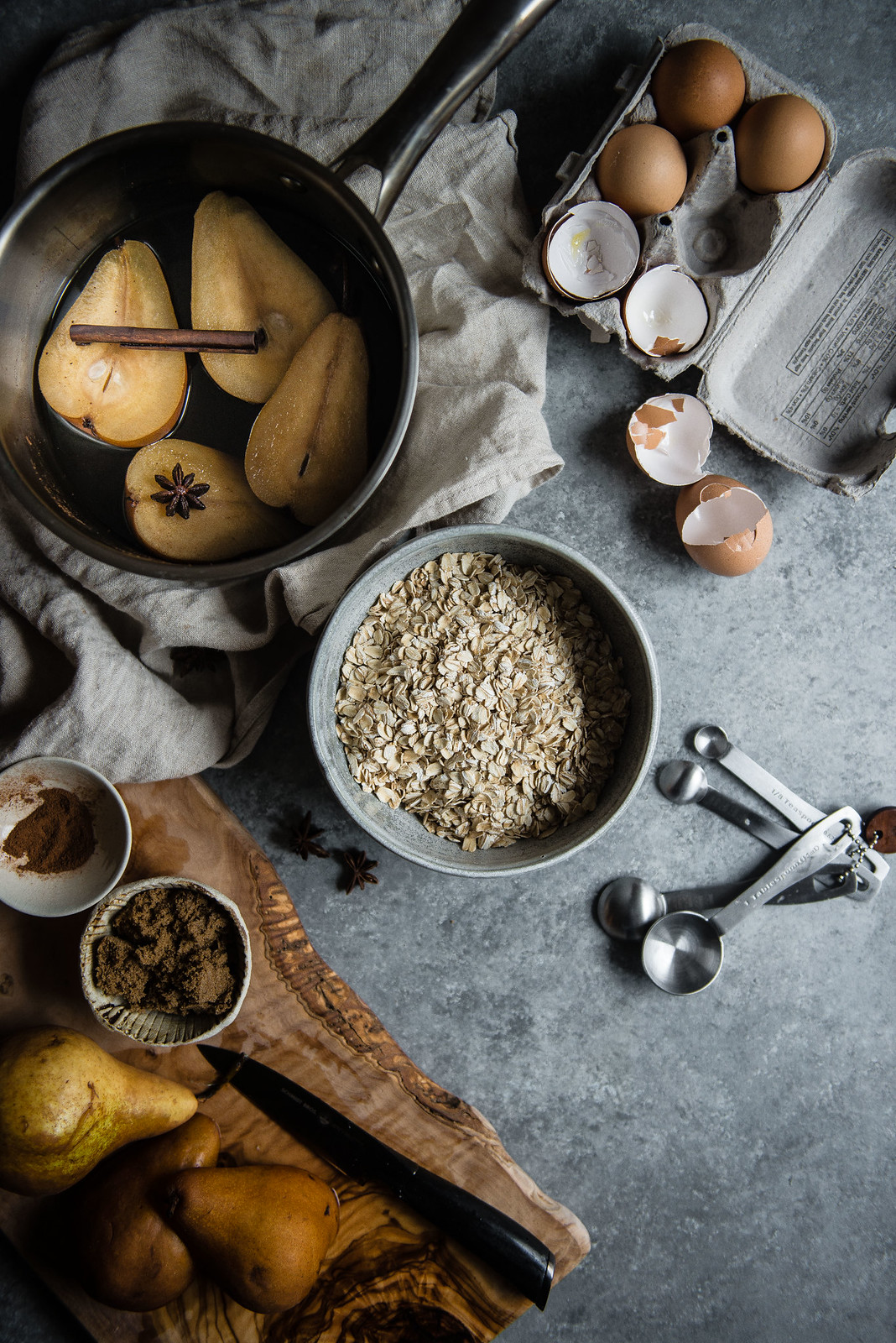 poached pear baked oatmeal | two red bowls