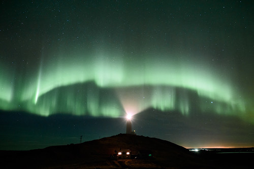 Rykjanes lighthouse under auroras