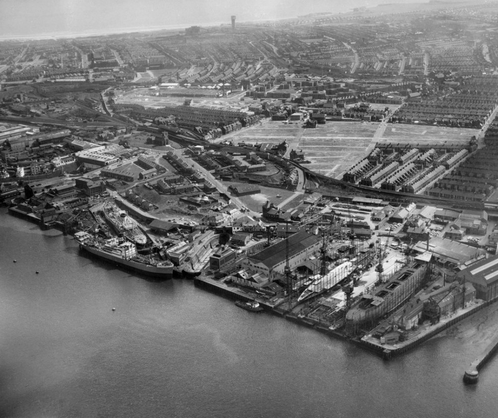 Aerial view of the shipyard of John Readhead & Sons and beyond