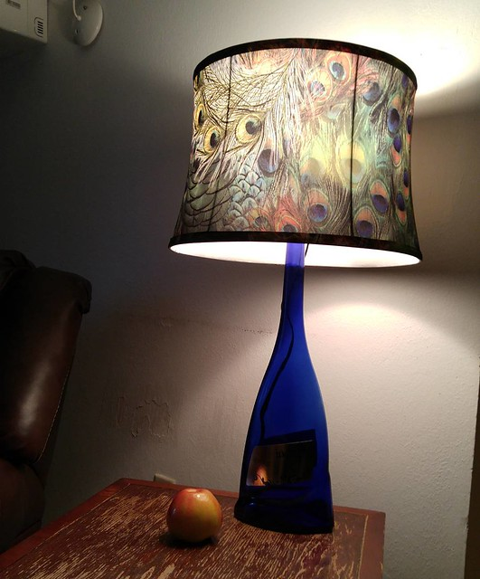 A lamp I made out of a huge wine bottle. Apple provided for scale.