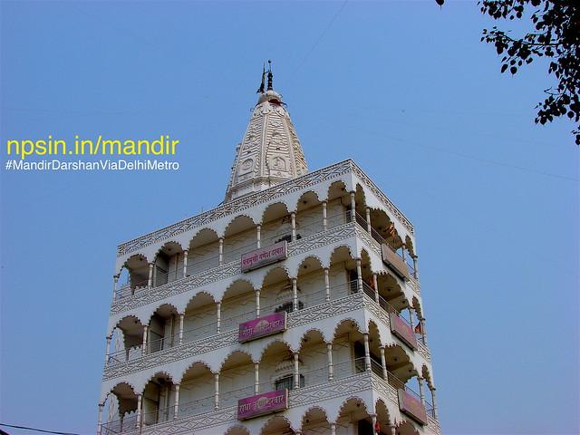 Top four floors with fifth floor as viman of Shri Sanatan Dharam Temple, this picture capture from Fruit Market (Fal Mandi), Tilak Nagar.