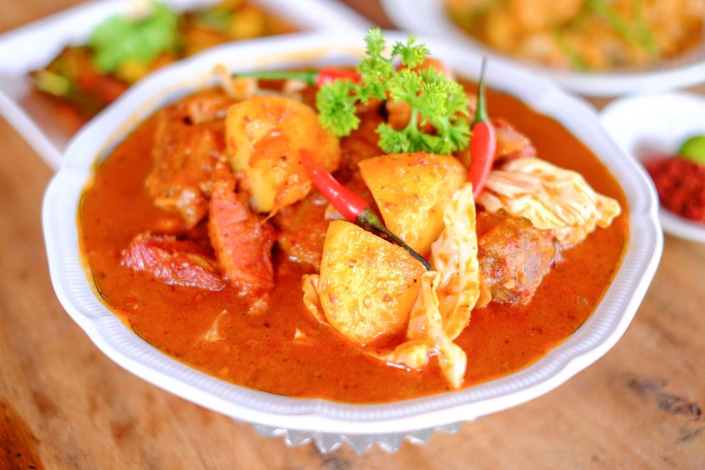 昆汀是欧亚餐厅的菠萝虾咖喱