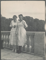 Two women standing by a wall