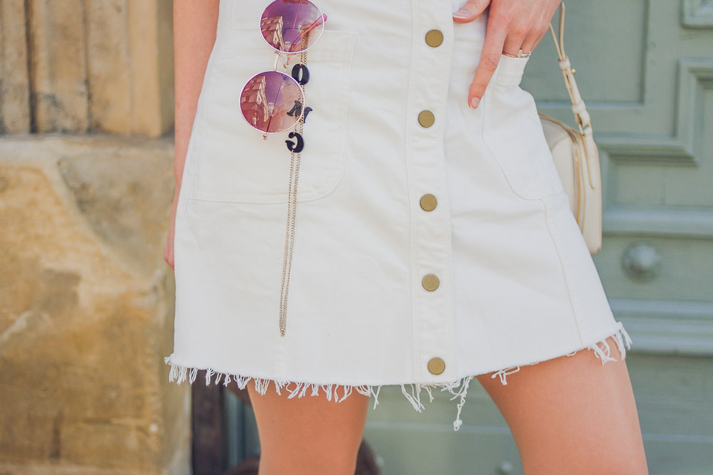 white denim cut off button up skirt boden sunglasses in pocket