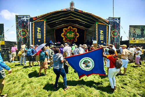 Belize flag at Congo Square Stage at Jazz Fest 2016 Day 1.  Photo by Eli Mergel