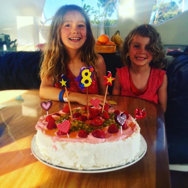 012/365 • flashback four days ago - the Smalls and the pavlova birthday cake - topped with strawberry cream, raspberries, strawberries and passionfruit • #012_2016 #zoeiseight #8yo #5yo #catamaran #boatyard #birthday #latergram #sisters #Summer2016