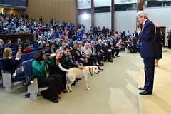 U.S. Secretary of State John Kerry, with his dog Ben, delivers remarks at the U.S. Department of State's annual 'Take Your Child to Work Day,' on April 28, 2016, in Washington, D.C. [State Department photo/ Public Domain]