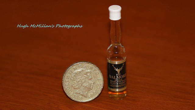 The Dalmore Single Malt Highland Scotch Whisky. beside an British pound coin.