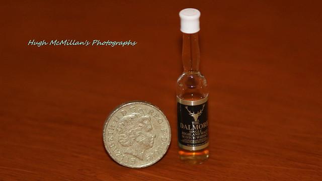 The Dalmore Single Malt Highland Scotch Whisky. beside an British pound coin.