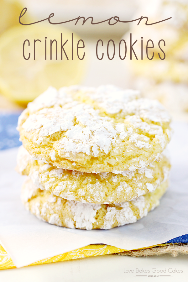Lemon Crinkle Cookies stacked up on parchment paper.