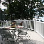 DuraLife Siesta decking in Coastal Grey with White Railways railing