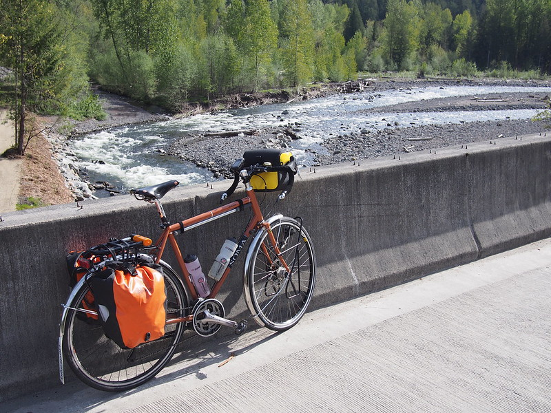 Toasty Tangerine Over Puyallup River: Showing off the new Ortlieb handlebar bag.
