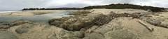 Black hooded figure on the Carmel River Beach/teepee too