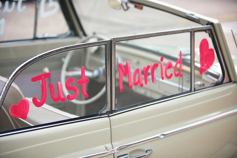 convertible car words just married painted on side window