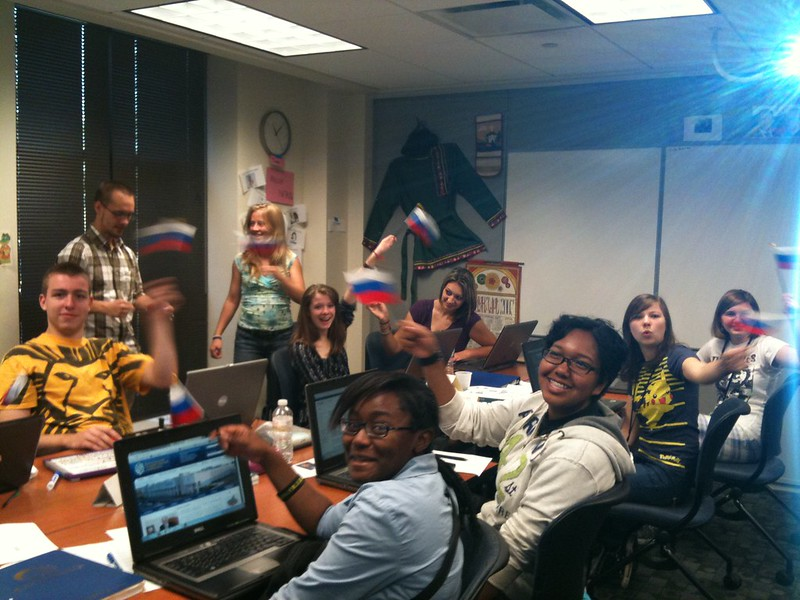 Tue, 07/10/2012 - 11:07am - Russian foreign language academy students at their computers waving Russian flags.