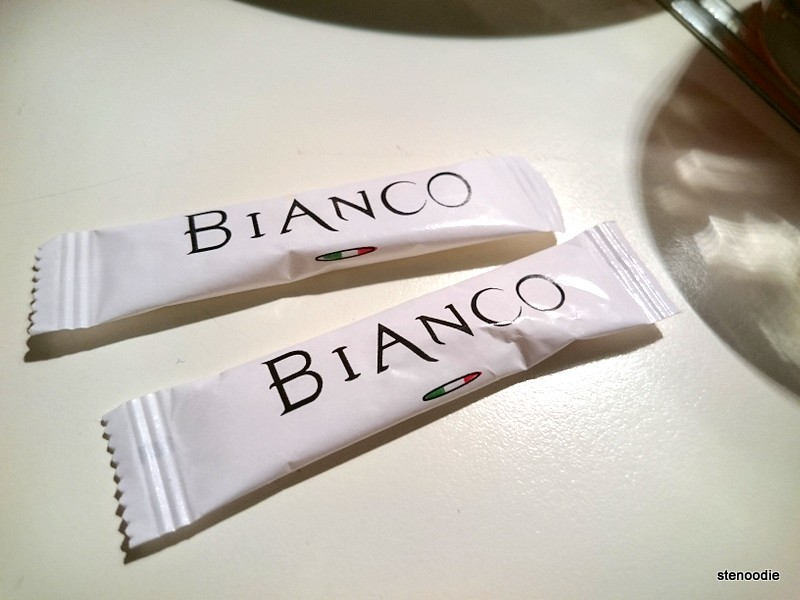 Sugar packets with the name of the restaurant Bianco on it