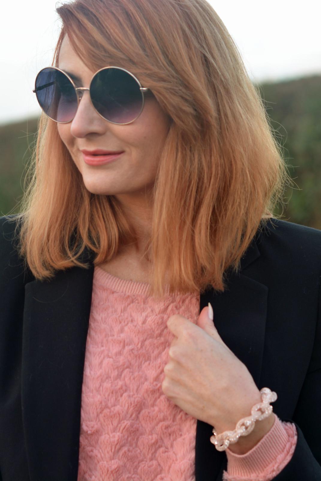 Black blazer, pink sweater, sparkly link bracelet