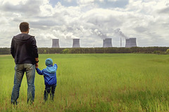 Pollution. Environmental problem. Father and his  son looking on a emissions of plant.