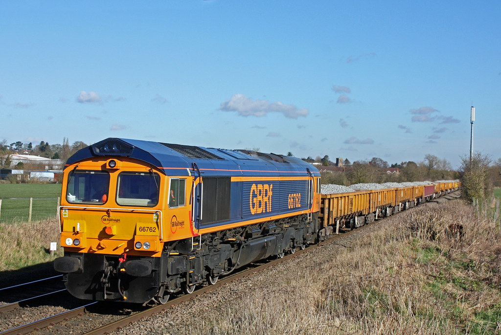 GBRf 66762 yet un-named powers towards Narborough Foot Crossing west of the station on 18.2.16 with 6G16 1123 Cliffe Hill Stud Farm - Bescot Up Engineers Sdgs loaded ballast boxes