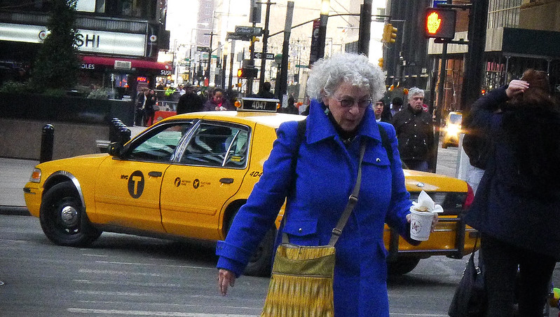 Woman in Blue Coat and Taxi