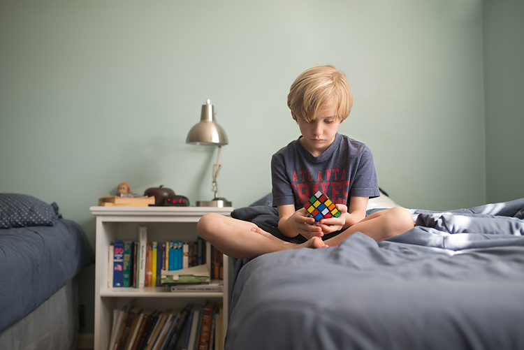 boy playing with rubiks cube 01-750