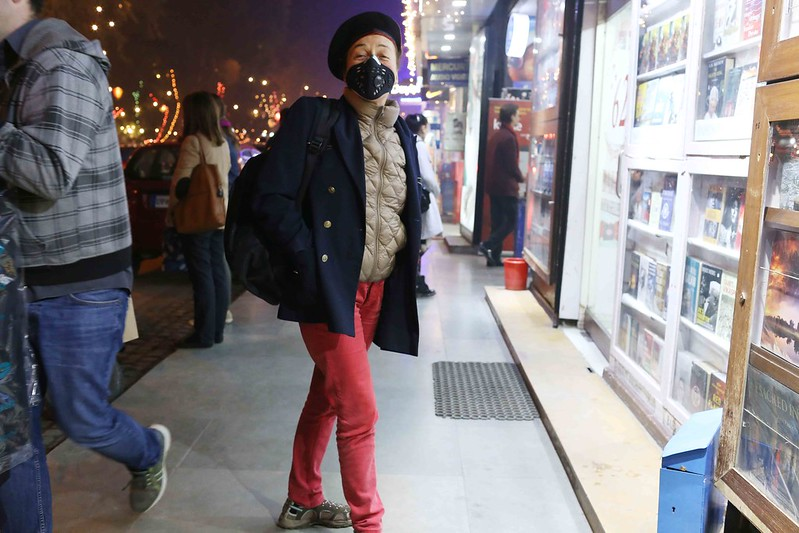 City Moment - The Woman in the Anti-Pollution Mask, Khan Market