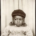 Small photo of Photo booth portrait of an African American boy