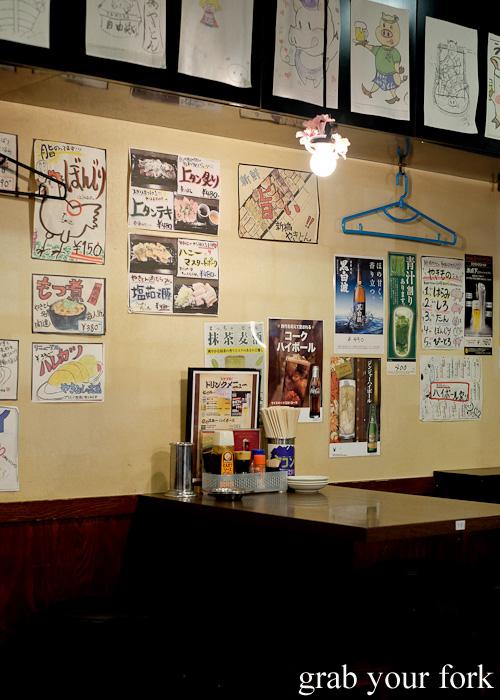Dining room with hand drawn menus inside Yakiton at Shinjuku, Tokyo