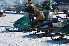 Starting a Vintage Snowmobile -- Snowmobile racing and show on Houghton Lake, Michigan