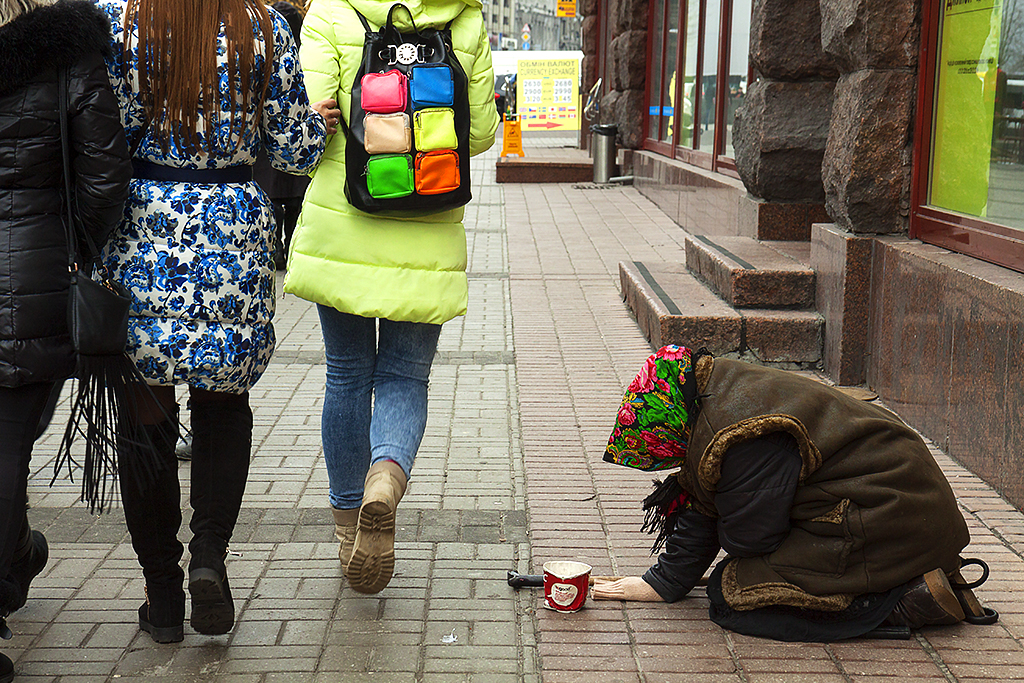 Old woman kneeling on the ground, begging--Kiev 2