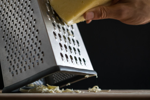 grating the creamy fontina