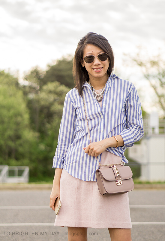 blue and white striped shirt, mixed pearl statement necklace, pink wool shift dress, nude crossbody bag