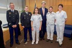 U.S. Secretary of State John Kerry poses with French nurses and a helicopter flight crew on May 2, 2016, as he visited the U.S. Mission in Geneva, Switzerland, and thanked the first responders who treated him after he broke his leg in a biking accident in nearby France on May 31, 2015. [State Department photo/ Public Domain]