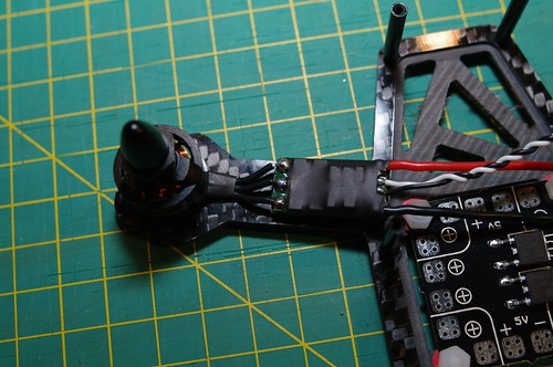 Soldered motor mounted on arm