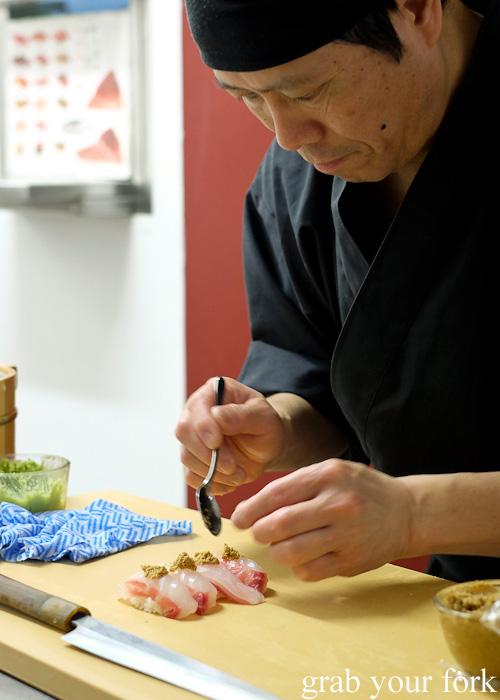 Chef Shinji Matsui adding cooked snapper roe to kampachi at Sashimi Shinsengumi, Crows Nest