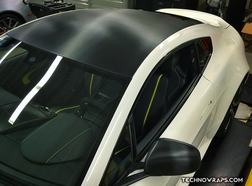 Car roof wrapped in black carbon fiber vinyl