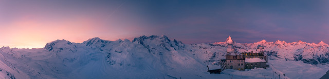 the sun rising behind Monte Rosa