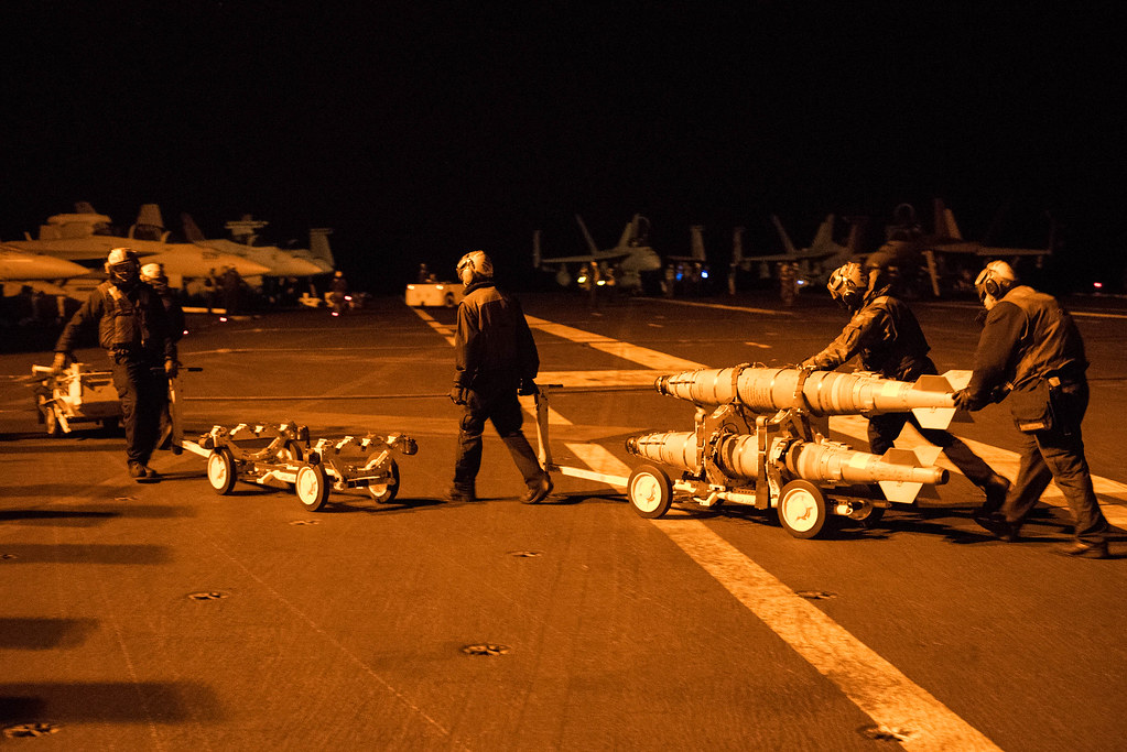 Sailors transport ordnance aboard USS Harry S. Truman.