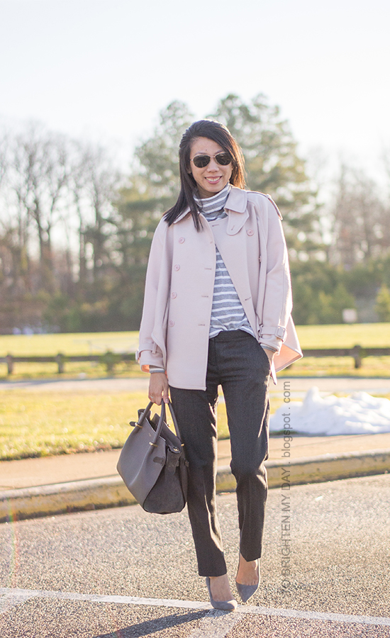 pink trench cape, gray striped turtleneck, gray wool trousers, gray suede pumps