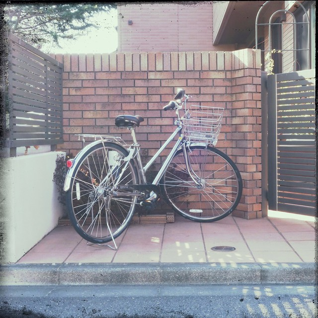 Parked Bicycle in front of house