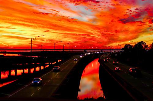 bridge blue sunset sky orange car yellow skyline clouds twilight highway automobile bright dusk alabama daphne interstate i10 mobilebay