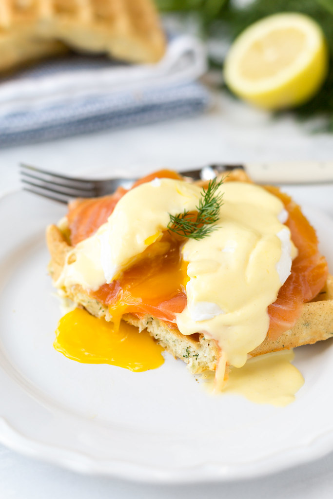 poached egg yolk on smoked salmon eggs benedict