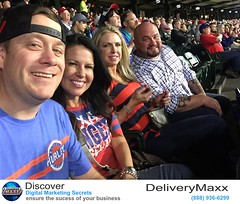 CEO of DeliveryMaxx Josh Deaton with his wife Amy and friends cheering on the Rangers!