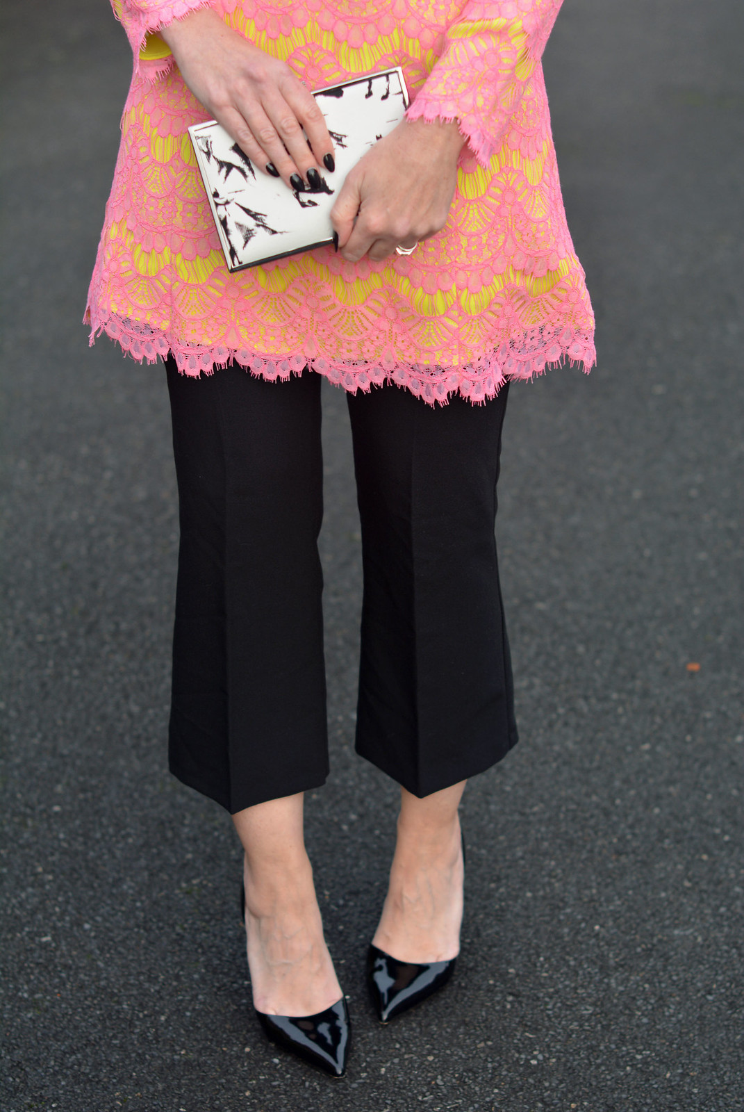Not Dressed As Lamb | Pink and yellow lace French Connection dress layered over black cropped trousers, printed box clutch