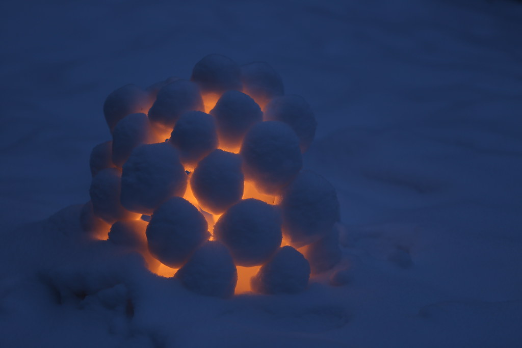 Candlelight in the snowy blue evening