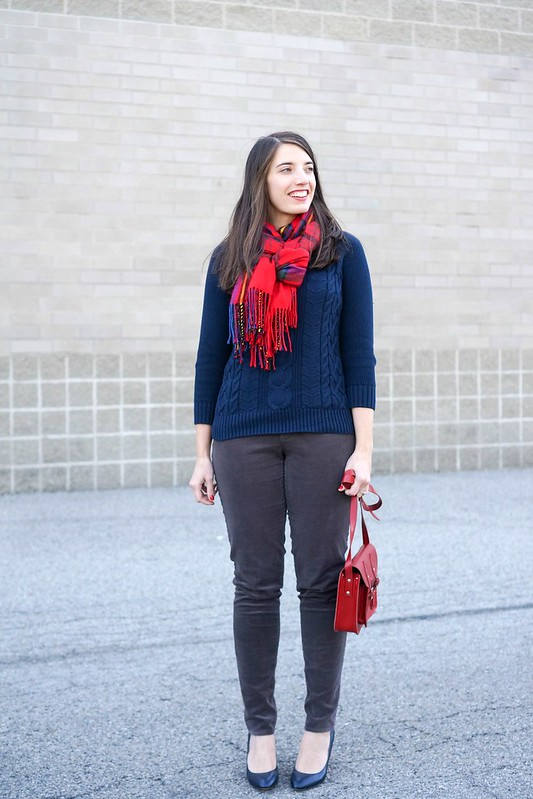 plaid scarf + navy cable sweater + gray cords + red crossbody purse