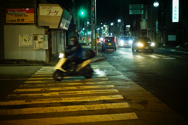 a scooter on the yellow zebra zone