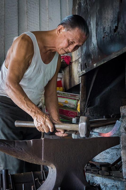 Blacksmith Sri Gading - forging on the anvil